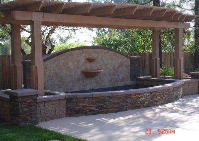 Stone fountain with el dorado ledgestone vaneer and patio cover built by AJM Construction Service, Orange County, CA