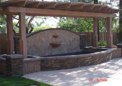 Stone fountain with el dorado ledgestone vaneer and patio cover built by AJM Construction Service, Orange County, CA